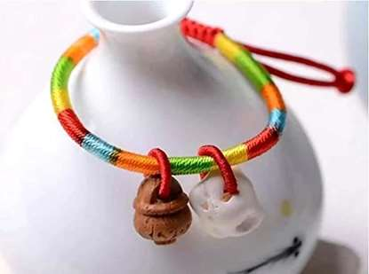 Picture of Porcine Bone and Carved Peach Basket Anti-shock Kids Infants Five-color Thread Charm Bracelet